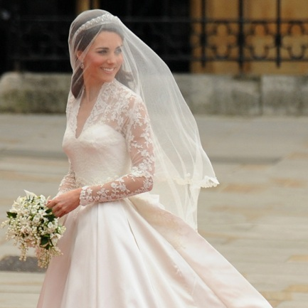 Kate Middleton smiles as she arrives at the West Door of Westminster Abbey in London for her wedding to Britain's Prince William, on April 29, 2011. AFP PHOTO / BEN STANSALL (Photo credit should read BEN STANSALL/AFP/Getty Images)