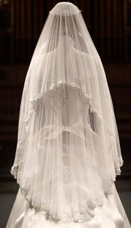 EMBARGOED UNTIL GMT 2301 July 21, 2011. The wedding dress of Britain's Catherine, Duchess of Cambridge is seen as it is prepared for display at Buckingham Palace in London July 20, 2011. Buckingham Palace expects record crowds this summer as up to 650,000 people are set to file into Queen Elizabeth's London residence and past the dress worn by Kate Middleton at her royal wedding to Prince William. The ivory and white garment, designed by Sarah Burton for Alexander McQueen, won over the fashion press and public when Middleton, now the Duchess of Cambridge and a future queen, walked up the aisle of Westminster Abbey in April. Picture taken July 20, 2011. REUTERS/Lewis Whyld/Pool (BRITAIN - Tags: ROYALS TRAVEL SOCIETY ENTERTAINMENT) TEMPLATE OUT